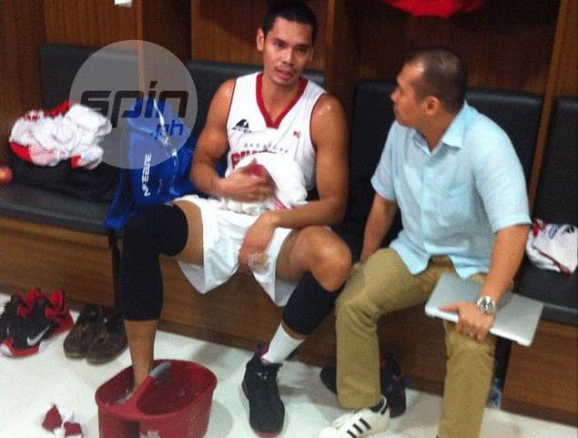 Aguilar ices the sprained foot inside the Ginebra dugout. Richard Dy