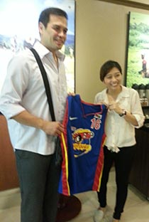 Former Purefoods star Alvin Patrimonio gifts longtime fan Danica Caynap a game jersey from his final playing year in 2004.
