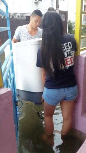 Jaypee Belencion and wife Nikki at the height of the flooding. Photo from Snow Badua