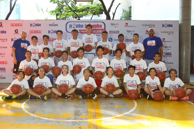 Kai Sotto (middle) towers over other Jr. NBA campers.