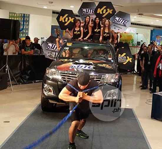 Strongman Moises Torcator shows his toughness by pulling a fully-loaded truck at the RUTE launch in SM Megamall.
