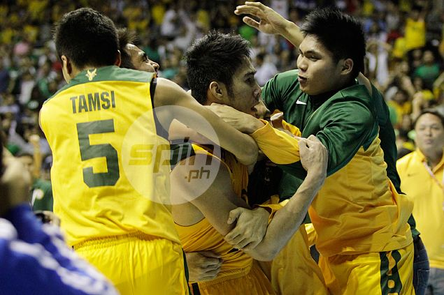 FEU's team-first philosophy was none more apparent than in the endgame when Mike Tolomia made his biggest play of the game not with a shot but with a pass that set up Mac Belo for the game-winning three-pointer at the buzzer. Jerome Ascano