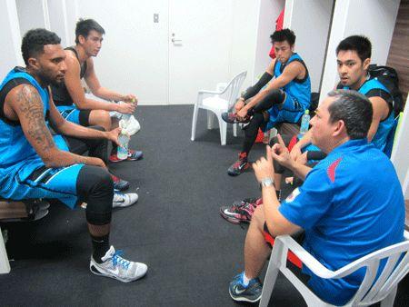 Manila West huddles with coach John Flores.