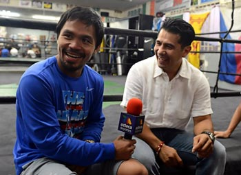 Pacquiao is all smiles as he is interviewed by former rival Marco Antonio Barrera. Photo by Mike Quidilla