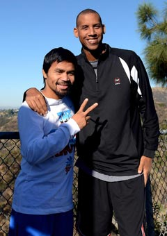 Manny Pacquiao and Reggie Miller pose for the cameras. Photo by Mike Quidilla/MP Promotions
