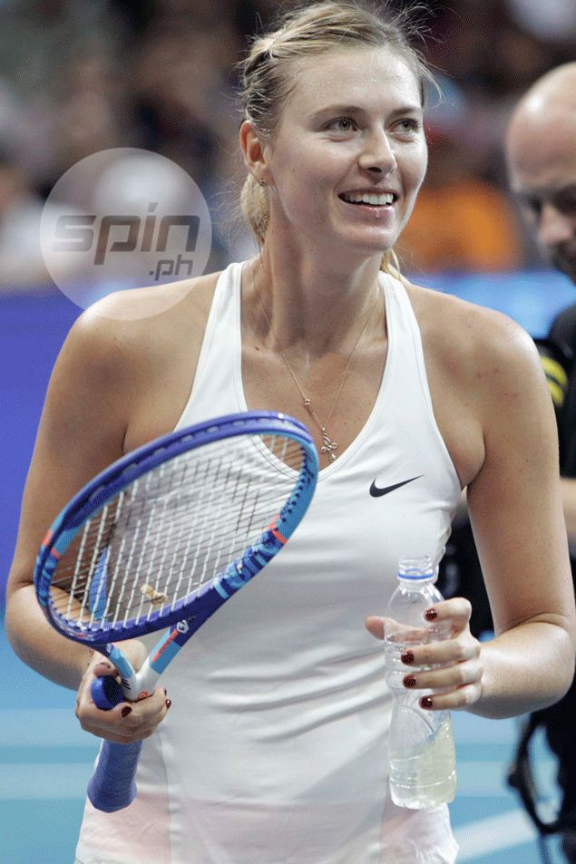 Sharapova wins a point, wins hearts as well with that charming smile.