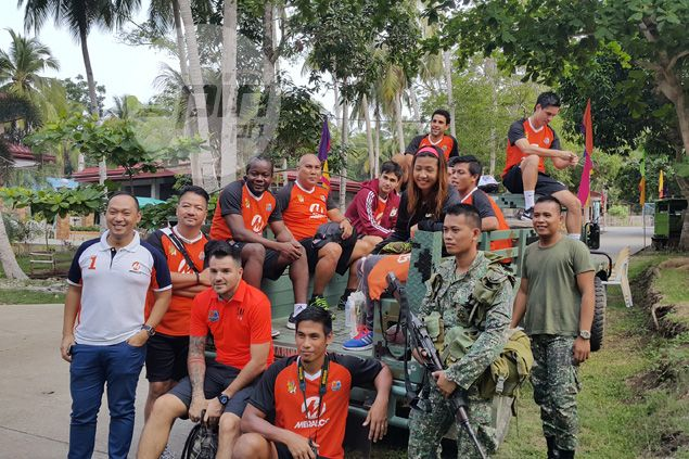 Loyola Meralco Sparks share a souvenir photo with their Marine escorts.
