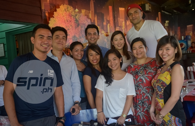 One-time PBA MVP Asi Taulava poses with his hosts from Spin.ph. Photo by Jaime Campos