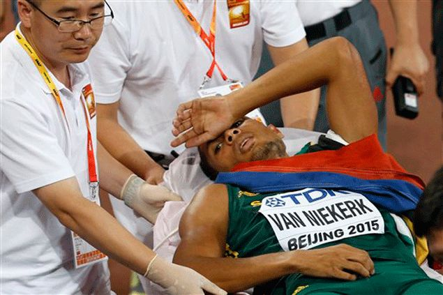South Africa's Wayde Van Niekerk lies on a stretcher after winning the gold medal in the men's 400m final during the World Athletics Championships. AP