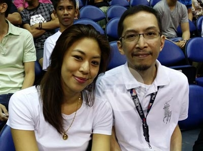 Nino Reyes, pictured with wife, left no stone unturned in Terrence Romeo's return from a back injury. Photo by Snow badua