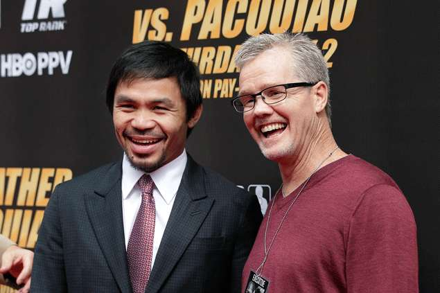 Trainer Freddie Roach says Pacquiao will 'kick the ass' of Mayweather. AP