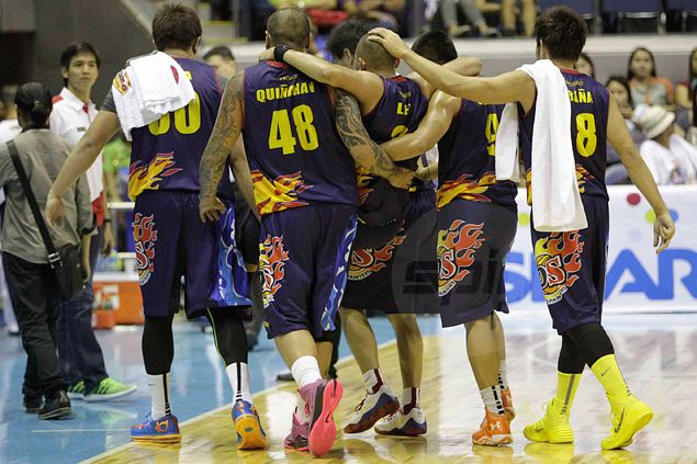 Paul Lee walks back to the bench with the help of teammates. Jerome Ascano