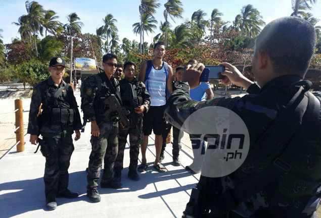 Japeth Aguilar poses with soldiers who keep the PBA delegation safe. Snow Badua