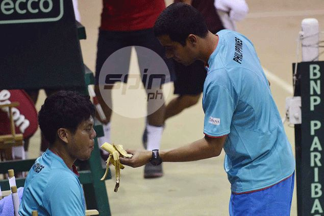 PJ Tierro gets a banana from coach Roland Kraut during a break. Freddie Dionisio