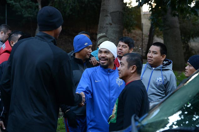 Manny Pacquiao and NBA legend Reggie Miller exchange pleasantries before their morning run. Photo by Mike Quidilla/MP Promotions