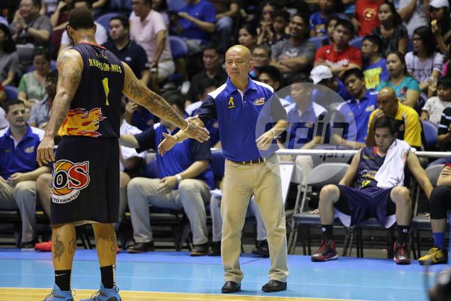 Coach Yeng Guiao daps it up with Pierre Henderson-Niles.