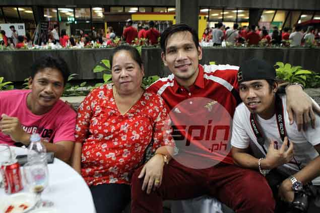 SMB star June Mar Fajardo celebrates another championship with his family.