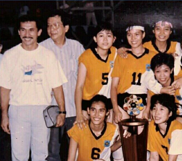 The UST Tigresses coached by August Sta. Maria during their reign. Natalie Cruz is the one on the far right, standing. Photo from Mozzie Ravena