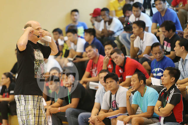 Vance Walberg holds a talk about his famed 'dribble drive' offense before a group that included some of the country's top coaches led by two-time PBA grand slam coach Tim Cone.