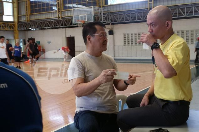 Yeng Guiao and Beau Belga's agent Danny Espiritu had a lengthy discussion before Rain or Shine practice on Monday. Snow Badua