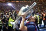 Lionel Messi kisses the Champions League trophy after Barcelona defeated Juventus, 3-1, in the final at the Olympic stadium in Berlin on June 6, 2015. AP Photo/Martin Meissner