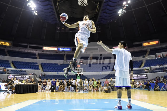 Rey Guevarra edges flying Newsome to complete Slam Dunk contest three-peat