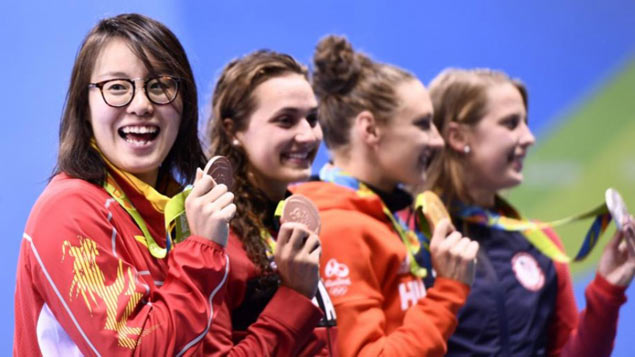 Chinese swimmer Fu Yuanhui wins public's heart for rare candor and wacky expressions in Rio