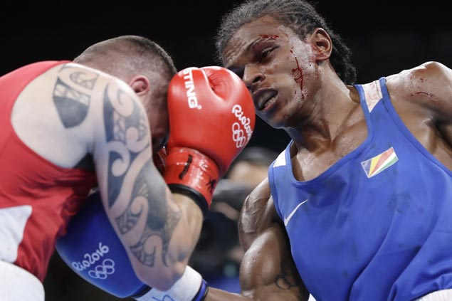 Olympic boxers torn in fighting without headgear as Rio boxing riddled with bloody fights