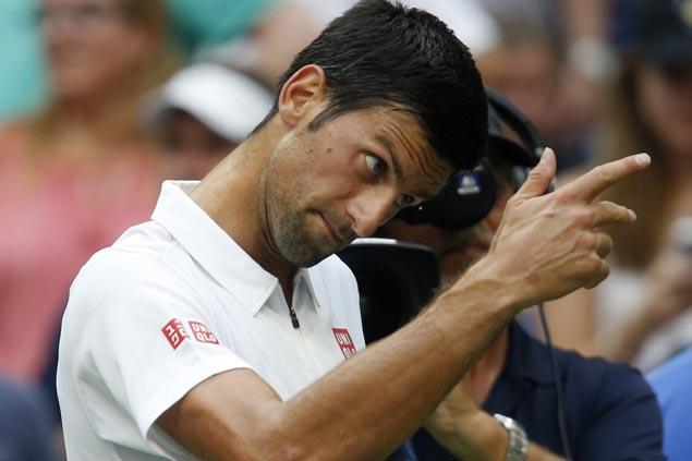 Another free pass for Novak Djokovic as Mikhail Youzhny withdraws injured