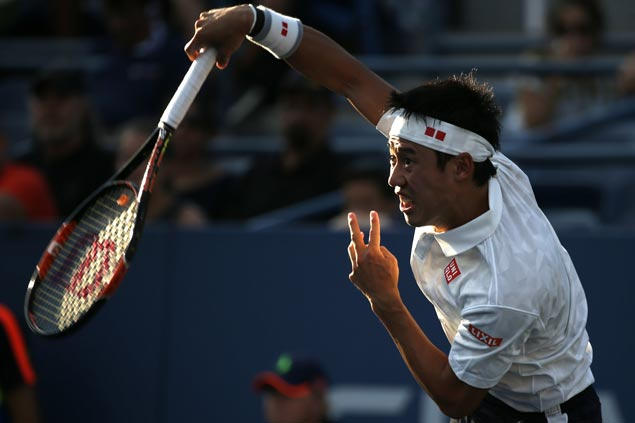 Kei Nishikori marches on to last eight with straight-sets victory over Ivo Karlovic