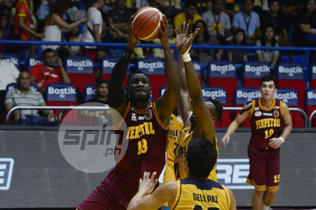 Bright Akhuetie powers Perpetual past JRU in double OT to secure playoff for Final Four berth