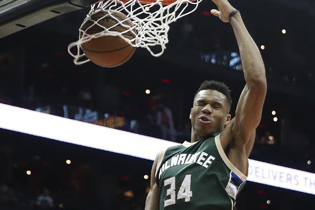 Milwaukee Bucks, Giannis Antetokounmpo agree to four-year, $100 million extension, say sources