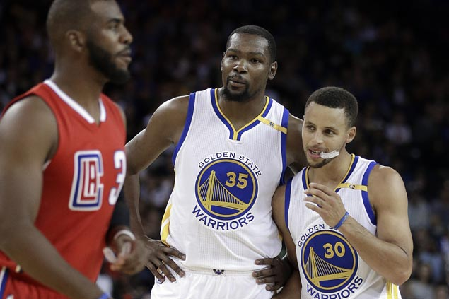 Klay Thompson, Kevin Durant combine for 51 points as Warriors torch Clippers in home debut
