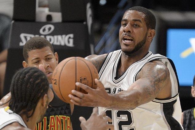 Aldridge says he's happy in San Antonio, denies trade rumors that he won't end season with Spurs