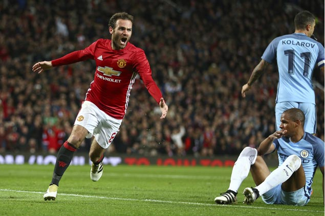 Juan Mata delivers winning goal as United exacts revenge on City in Manchester derby