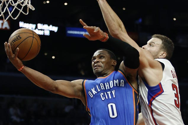 Westbrook cleans up errors with clutch hits as Thunder downs Clippers to stay unbeaten in West