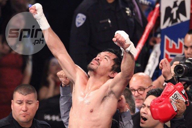 Manny Pacquiao celebrates a glorious comeback. Jhay Otamias