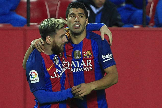 Messi nabs 500th goal, sets up Luis Suarez winner to lift Barcelona over gritty Sevilla