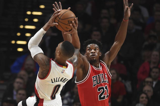 Bulls shackle Lillard as Chicago routs Portland to stretch win streak to three