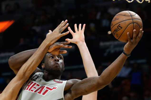Miami snaps six-game slump with furious fourth quarter run to zoom past Milwaukee
