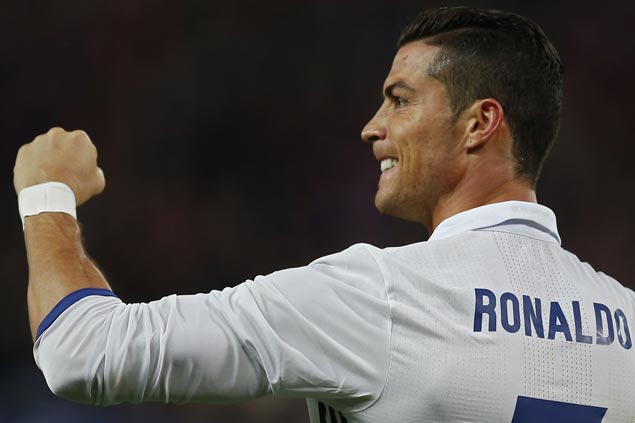 Cristiano Ronaldo scores hat-trick as Madrid blanks Atletico in derby