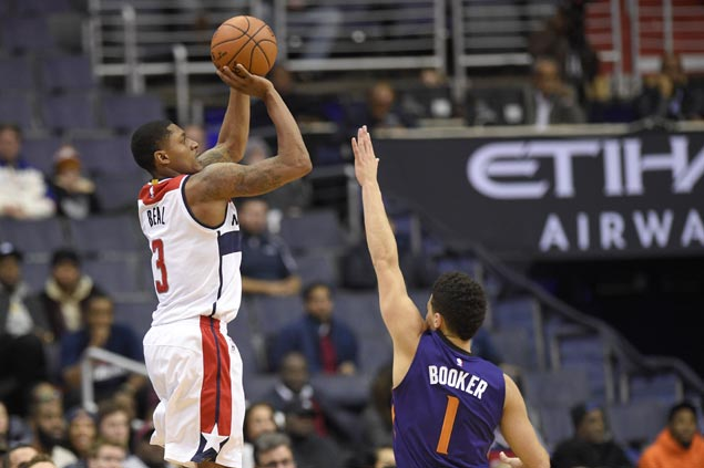 Beal drops career-high 42, Wall comes up clutch as backcourt duo carry Wizards past Suns