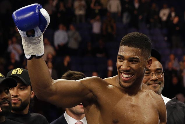 Anthony Joshua stops Carlos Takam in 10th round to retain heavyweight titles