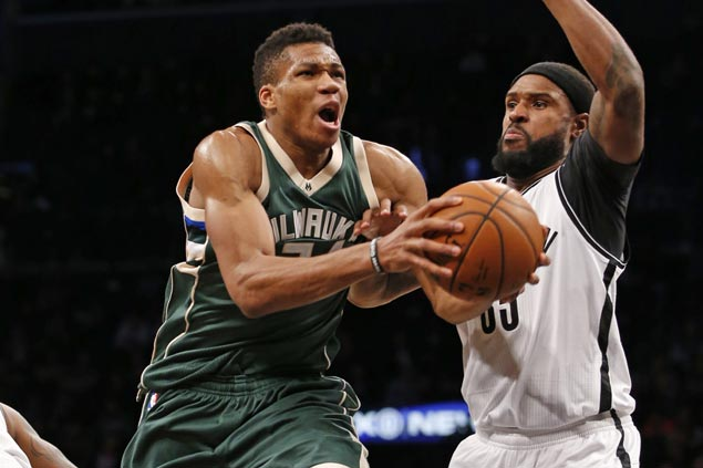 Bucks heat up from deep in the second half to gun down Nets, roll to third straight win