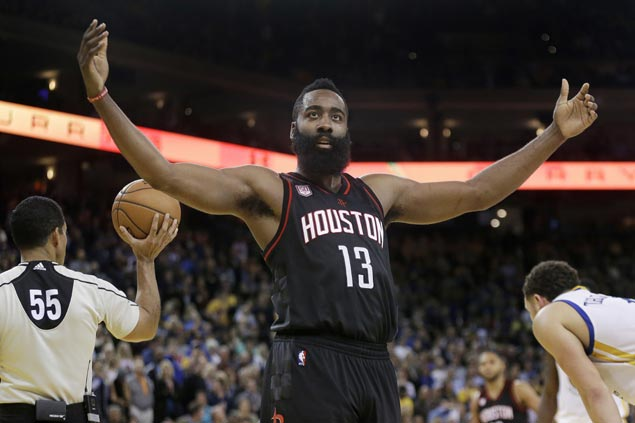 Rockets end Warriors' 12-game win streak by holding ground in two-overtime thriller