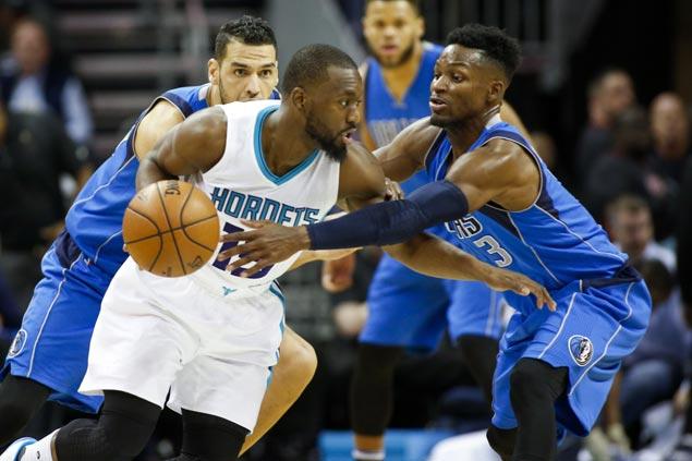 Kemba Walker comes up clutch as Hornets survive scare over league-worst Mavericks