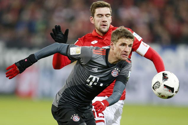 Bayern Munich takes provisional lead on goal difference with victory at Mainz