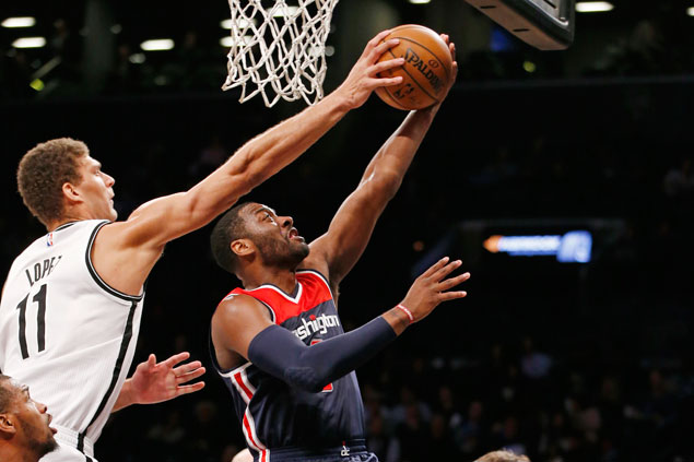 John Wall posts huge double-double as Wizards fight back from 16 points down to beat Nets
