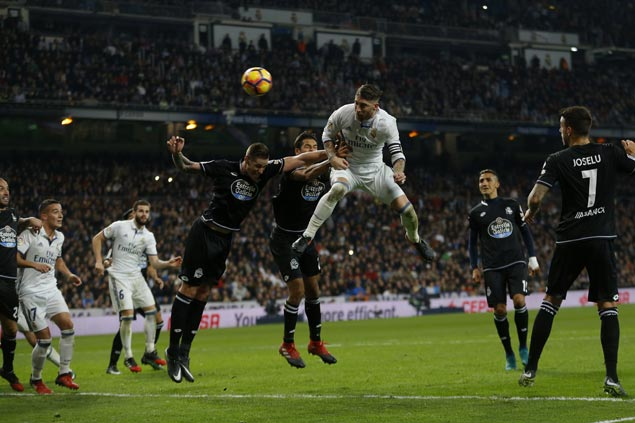 Real Madrid sets club record 35 straight games without a loss with slim win over Deportivo