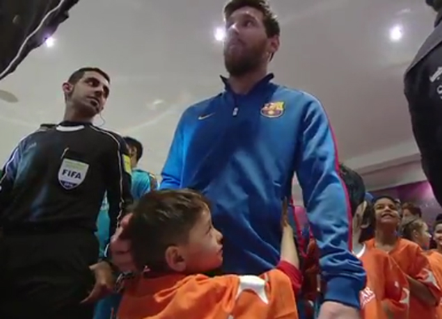 Afghan boy refuses to let go after dream meeting with idol Lionel Messi